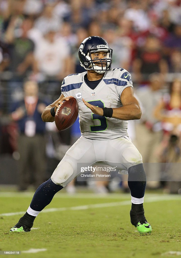 Quarterback Russell Wilson #3 of the Seattle Seahawks throws a pass during the NFL game against the Arizona Cardinals at the University of Phoenix Stadium on October 17, 2013 in Glendale, Arizona. The Seahawks defeated the Cardinals 34-22.