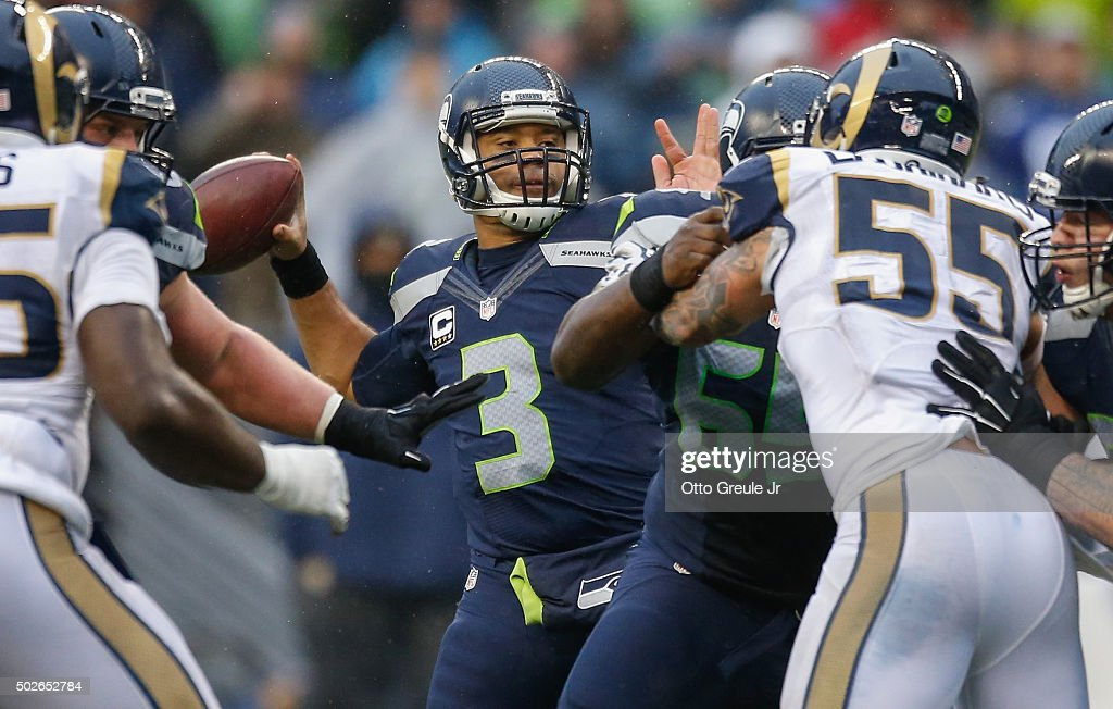 Quarterback Russell Wilson #3 of the Seattle Seahawks throws a touchdown pass to wide receiver Doug Baldwin in the third quarter against the St. Louis Rams at CenturyLink Field on December 27, 2015 in Seattle, Washington. The Rams defeated the Seahawks 23-17.