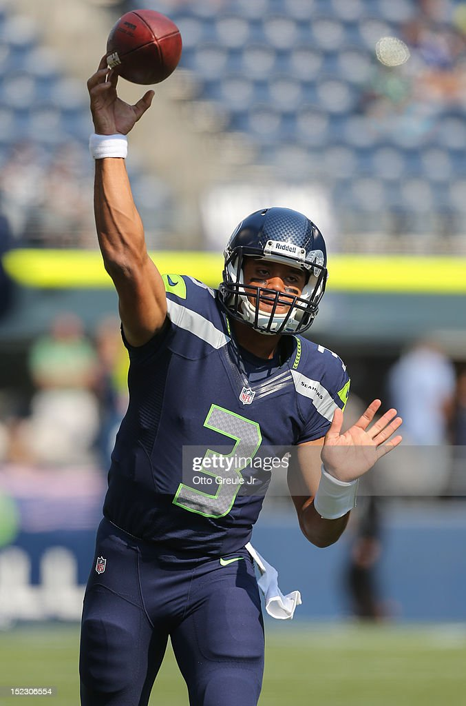 Quarterback <a gi-track='captionPersonalityLinkClicked' href=/galleries/search?phrase=Russell+Wilson+-+American+Football+Quarterback&family=editorial&specificpeople=2292912 ng-click='$event.stopPropagation()'>Russell Wilson</a> #3 of the Seattle Seahawks warms up prior to the game against the Dallas Cowboys at CenturyLink Field on September 16, 2012 in Seattle, Washington.