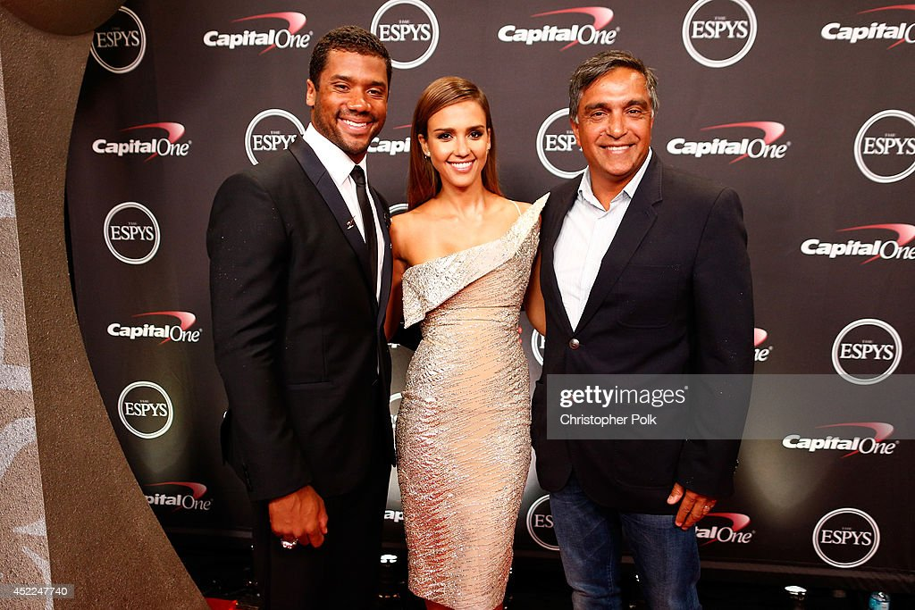 NFL quarterback <a gi-track='captionPersonalityLinkClicked' href=/galleries/search?phrase=Russell+Wilson+-+American+Football+Quarterback&family=editorial&specificpeople=2292912 ng-click='$event.stopPropagation()'>Russell Wilson</a> with actress <a gi-track='captionPersonalityLinkClicked' href=/galleries/search?phrase=Jessica+Alba&family=editorial&specificpeople=201811 ng-click='$event.stopPropagation()'>Jessica Alba</a> and her father Mark Alba attends The 2014 ESPYS at Nokia Theatre L.A. Live on July 16, 2014 in Los Angeles, California.