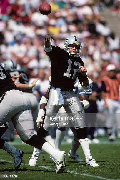 Quarterback Rusty Hilger of Los Angeles Raiders throws a pass during the game against the Detroit Lions at the Los Angeles Memorial Coliseum on...