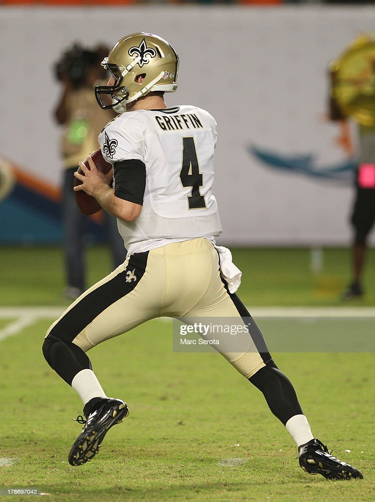 Quarterback Ryan Griffin #4 of the New Orleans Saints rolls out to throw the ball against the Miami Dolphins at Sun Life Stadium on August 29, 2013 in Miami Gardens, Florida. The Dolphins defeated the Saints 24-21.