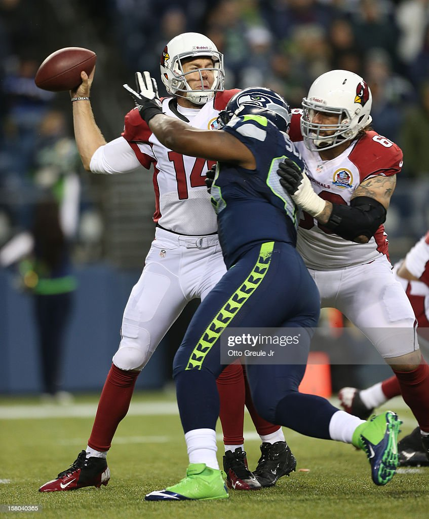 Quarterback Ryan Lindley #14 of the Arizona Cardinals passes under pressure from defensive end Greg Scruggs #98 of the Seattle Seahawks at CenturyLink Field on December 9, 2012 in Seattle, Washington. The Seahawks defeated the Cardinals 58-0.