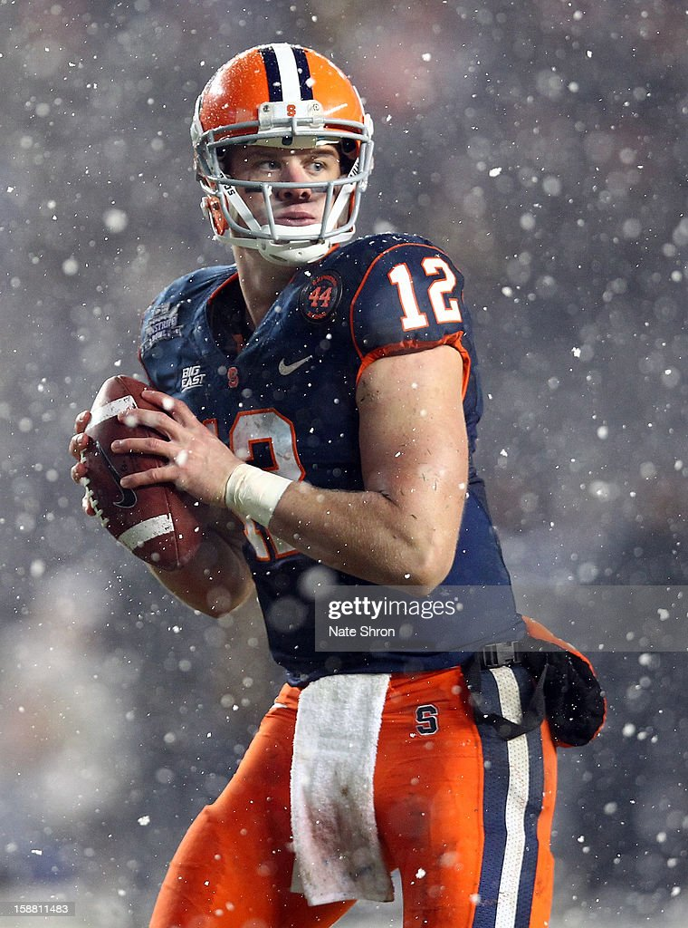 Quarterback Ryan Nassib #12 of the Syracuse Orange prepares to pass against the West Virginia Mountaineers during the New Era Pinstripe Bowl at Yankee Stadium on December 29, 2012 in the Bronx borough of New York City.