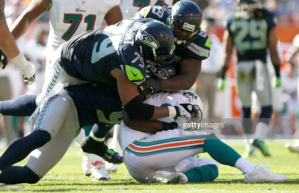 Quarterback Ryan Tannehill #17 of the Miami Dolphins is sacked by defensive Lineman Red Bryant #79 of the Seattle Seahawks at Sun Life Stadium on November 25, 2012 in Miami Gardens, Florida.