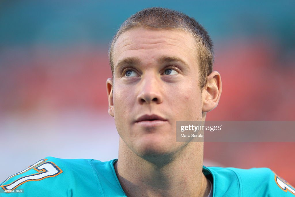 Quarterback <a gi-track='captionPersonalityLinkClicked' href=/galleries/search?phrase=Ryan+Tannehill&family=editorial&specificpeople=5573174 ng-click='$event.stopPropagation()'>Ryan Tannehill</a> #17 of the Miami Dolphins stands on the sidelines against the St. Louis Rams during a preseason game at Sun Life Stadium on August 28, 2014 in Miami Gardens, Florida. The Dolphins defeated the Rams 14-13.