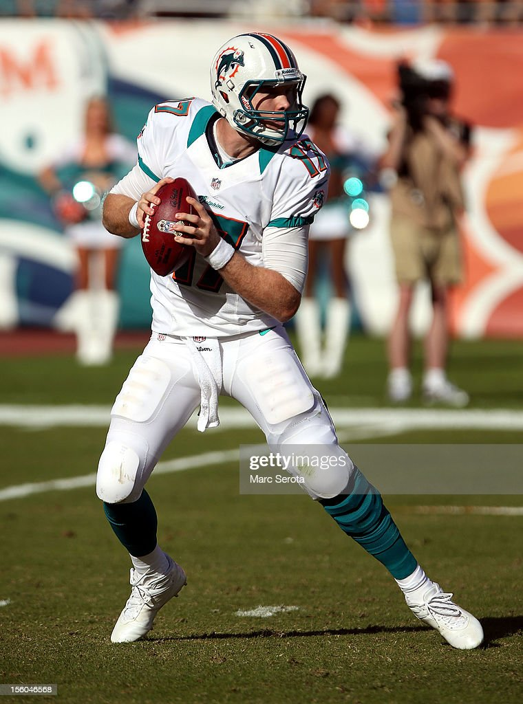 Quarterback <a gi-track='captionPersonalityLinkClicked' href=/galleries/search?phrase=Ryan+Tannehill&family=editorial&specificpeople=5573174 ng-click='$event.stopPropagation()'>Ryan Tannehill</a> #17 of the Miami Dolphins throws against the Tennessee Titans at Sun Life Stadium on November 11, 2012 in Miami Gardens, Florida.