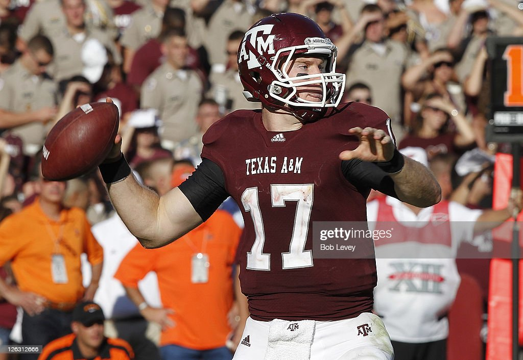 Quarterback Ryan Tannehill #17 of the Texas A&M Aggies looks for a receiver as he throws against the Oklahoma State Cowboys at Kyle Field on September 24, 2011 in College Station, Texas.