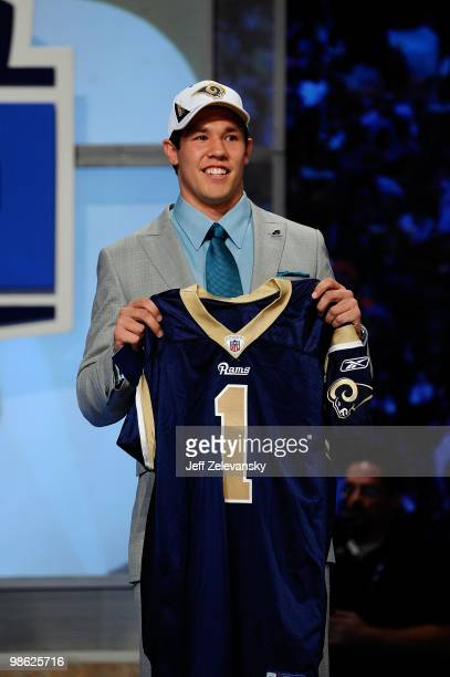 Quarterback Sam Bradford from the Oklahoma Sooners holds up a St Louis Rams jersey after the Rams selected Bradford numer 1 overall during the first...