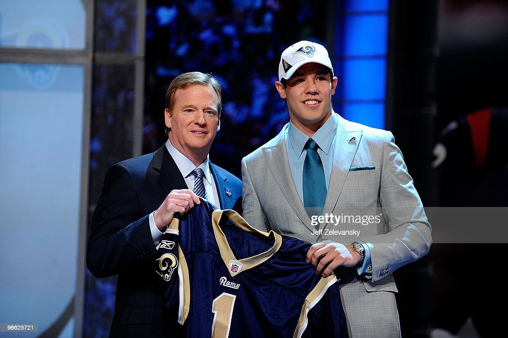 Quarterback Sam Bradford from the Oklahoma Sooners poses with NFL Commissioner Roger Goodell as they hold up a St Louis Rams jersey after the Rams...