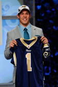 Quarterback Sam Bradford of the Oklahoma Soomers holds up a St Louis Rams jersey after he was picked numer 1 overall by the Rams during the 2010 NFL...