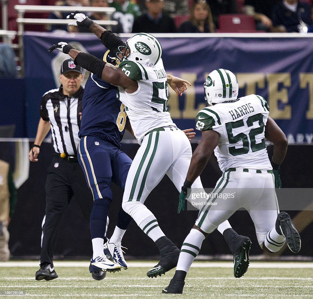 Quarterback Sam Bradford of the St Louis Rams is hit by outside linebacker Bryan Thomas of the New York Jets during the game at the Edward Jones Dome...