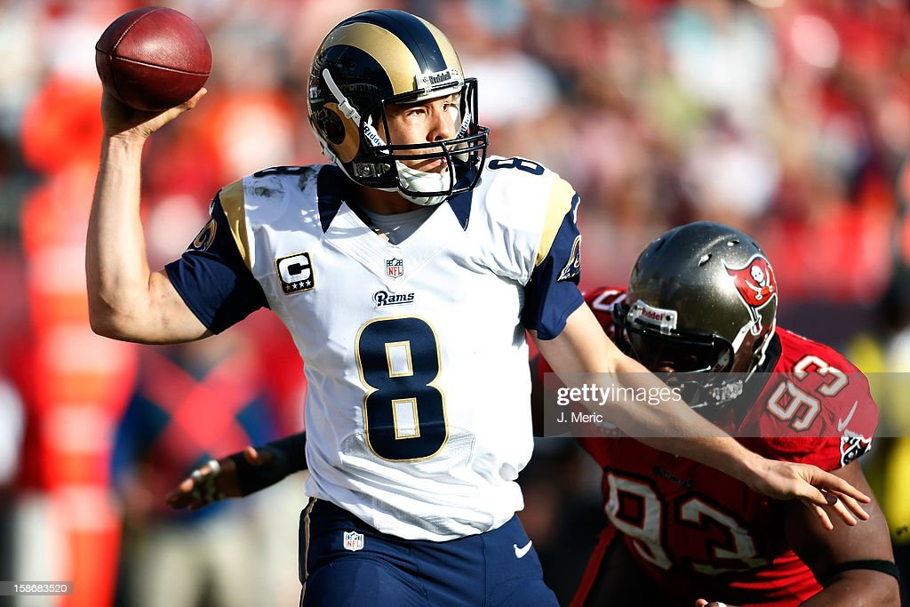 Quarterback <a gi-track='captionPersonalityLinkClicked' href=/galleries/search?phrase=Sam+Bradford&family=editorial&specificpeople=4489292 ng-click='$event.stopPropagation()'>Sam Bradford</a> #8 of the St. Louis Rams throws a pass as defender <a gi-track='captionPersonalityLinkClicked' href=/galleries/search?phrase=Gerald+McCoy&family=editorial&specificpeople=4524085 ng-click='$event.stopPropagation()'>Gerald McCoy</a> #93 of the Tampa Bay Buccaneers closes in during the game at Raymond James Stadium on December 23, 2012 in Tampa, Florida.
