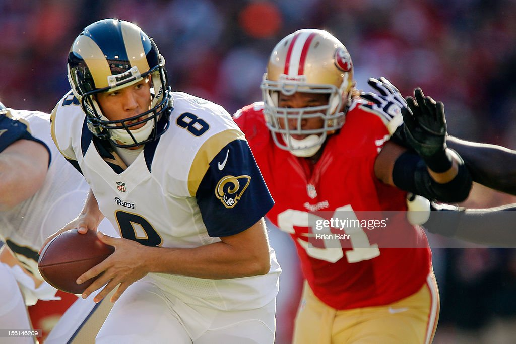 Quarterback <a gi-track='captionPersonalityLinkClicked' href=/galleries/search?phrase=Sam+Bradford&family=editorial&specificpeople=4489292 ng-click='$event.stopPropagation()'>Sam Bradford</a> #8 of the St. Louis Rams turns to hand the ball off under pressure from Safety Donte Whitner #31 of the San Francisco 49ers in the second half on November 11, 2012 at Candlestick Park in San Francisco, California. The teams tied 24-24 in overtime.
