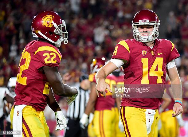 Quarterback Sam Darnold of the USC Trojans celebrates the touchdown of running back Justin Davis to take a 246 lead over the Arizona State Sun Devils...