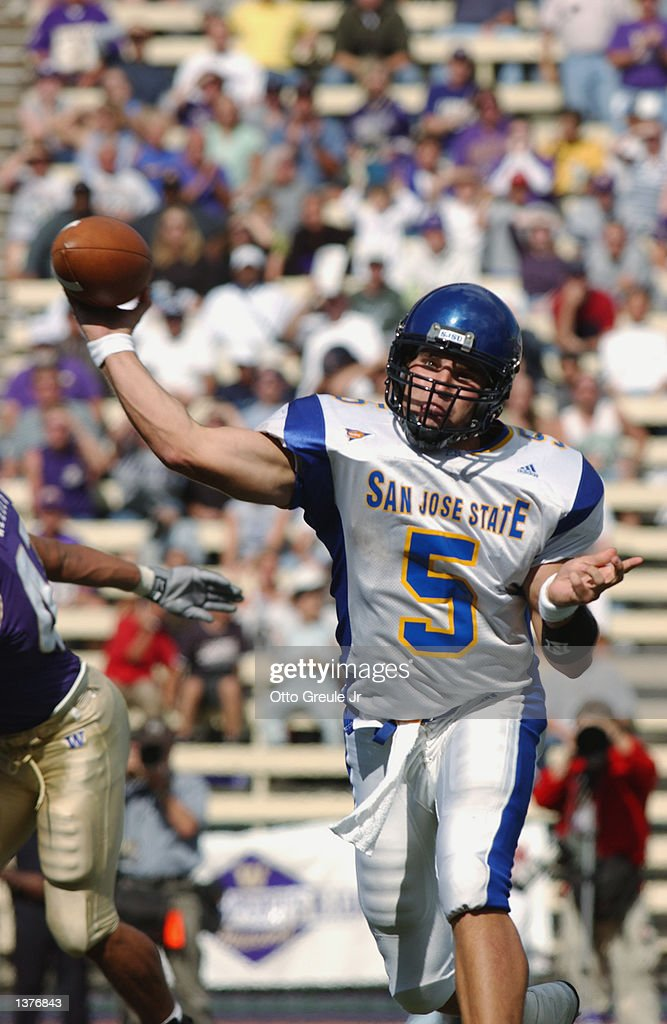 Quarterback Scott Rislov of the San Jose State Spartans throws a pass against the Washington Huskies during the game on September 7 2002 at Huskie...