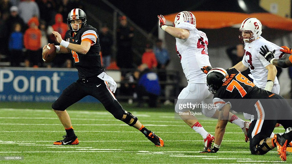 Quarterback <a gi-track='captionPersonalityLinkClicked' href=/galleries/search?phrase=Sean+Mannion&family=editorial&specificpeople=8221853 ng-click='$event.stopPropagation()'>Sean Mannion</a> #4 of the Oregon State Beavers runs away from pressure by linebacker Blake Lueders #43 and linebacker Trent Murphy #93 of the Stanford Cardinal during the fourth quarter of the game at Reser Stadium on October 26, 2013 in Corvallis, Oregon. Stanford won the game 20-12.