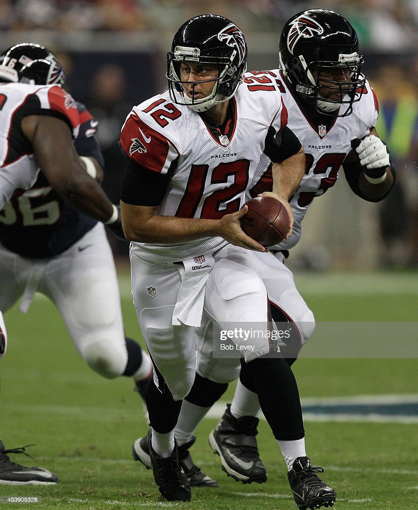 Quarterback Sean Renfree #12 of the Atlanta Falcons looks to hand off during a preseason game against the Houston Texans at Reliant Stadium on August 16, 2014 in Houston, Texas.
