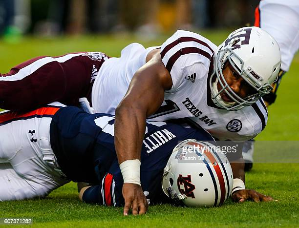 Quarterback Sean White of the Auburn Tigers is sacked by defensive lineman Myles Garrett of the Texas AM Aggies during an NCAA college football game...