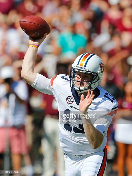 Quarterback Sean White of the Auburn Tigers throws a pass against the Mississippi State Bulldogs during the first half of an NCAA college football...