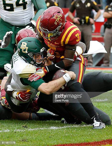 Quarterback Seth Russell of the Baylor Bears scores a touchdown as defensive back Mike Johnson of the Iowa State Cyclones blocks in the first half of...