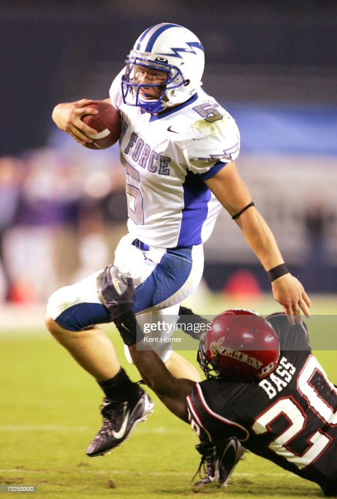 Quarterback Shaun Carney #5 of the Air Force Falcons runs with the ball against Ray Bass #20 of the San Diego State Aztecs on October 21, 2006 during their game at Qualcomm Stadium in San Diego, California. San Diego State won 19-12.