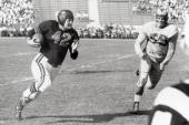 Quarterback Sid Luckman of the Chicago Bears runs past end Tom Fears of the Los Angeles Rams during a game played on November 7 1948 at the Los...