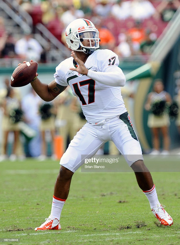 Quarterback Stephen Morris #17 of the Miami Hurricanes looks for an open receiver during the first quarter against the South Florida Bulls on September 28, 2013 at Raymond James Stadium in Tampa, Florida.