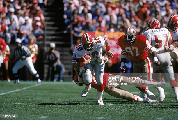 Quarterback Steve Bartkowski of the Atlanta Falcons tries to break a tackle as he scrambles for yards during a game against the San Francisco 49ers...