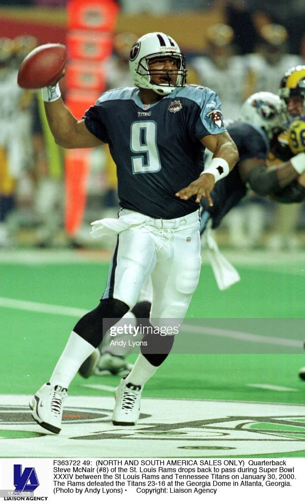 Quarterback Steve McNair of the St Louis Rams drops back to pass during Super Bowl XXXIV between the St Louis Rams and Tennessee Titans on January 30...