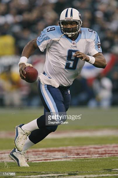 Quarterback Steve McNair of the Tennessee Titans runs on an open field during the AFC Championship game against the Oakland Raiders at Network...