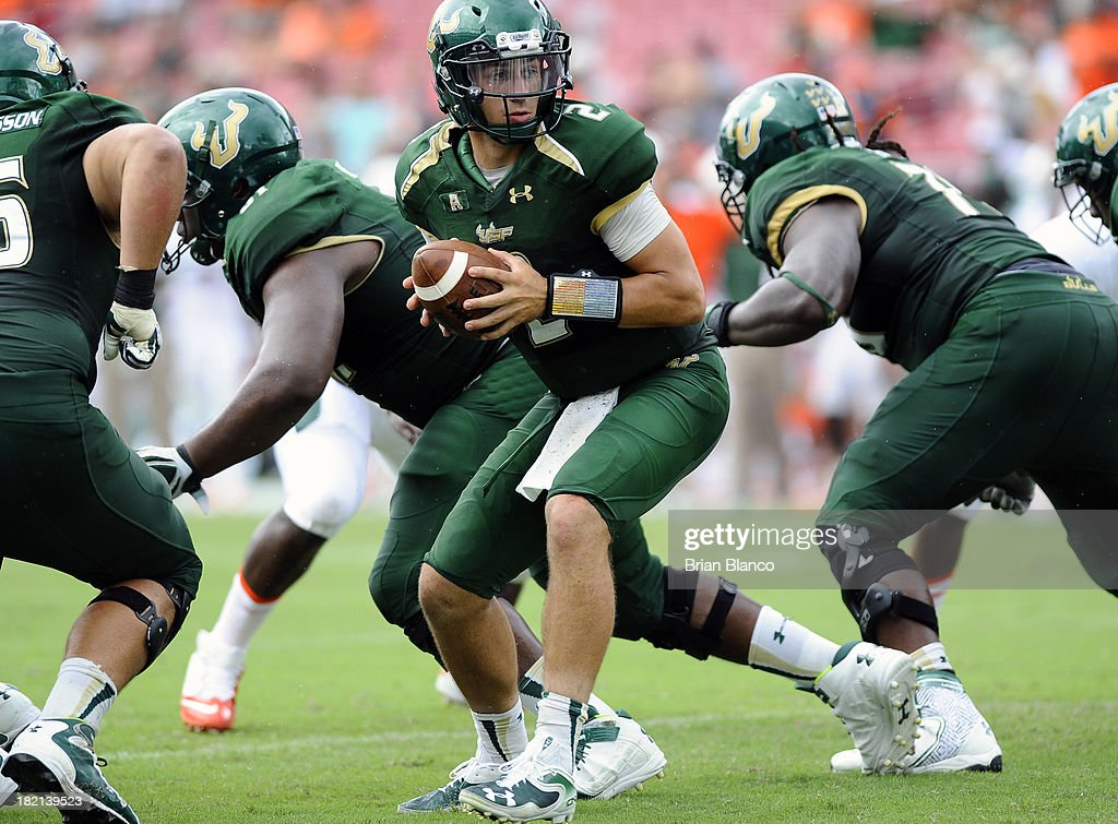 Quarterback Steven Bench #2 of the South Florida Bulls looks to hand off during the fourth quarter against the Miami Hurricanes on September 28, 2013 at Raymond James Stadium in Tampa, Florida.
