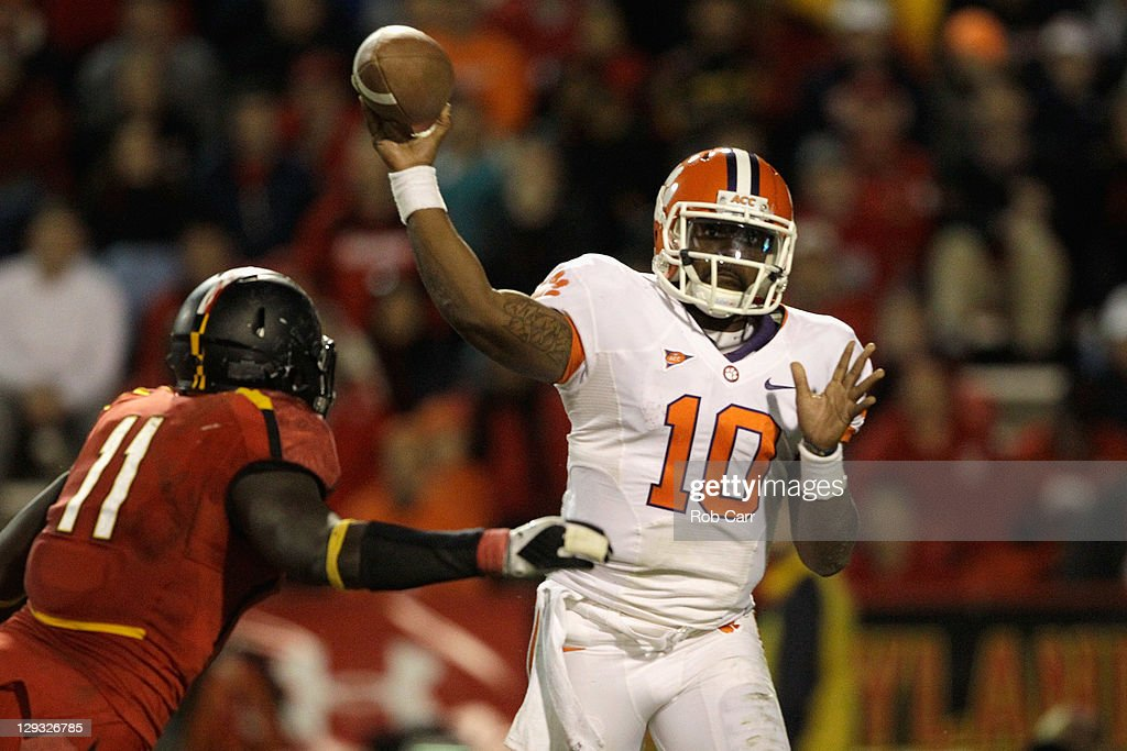 Quarterback Tajh Boyd #10 of the Clemson Tigers throws a pass while being pressured by defensive lineman David Mackall #11 of the Maryland Terrapins during the second half at Byrd Stadium on October 15, 2011 in College Park, Maryland.