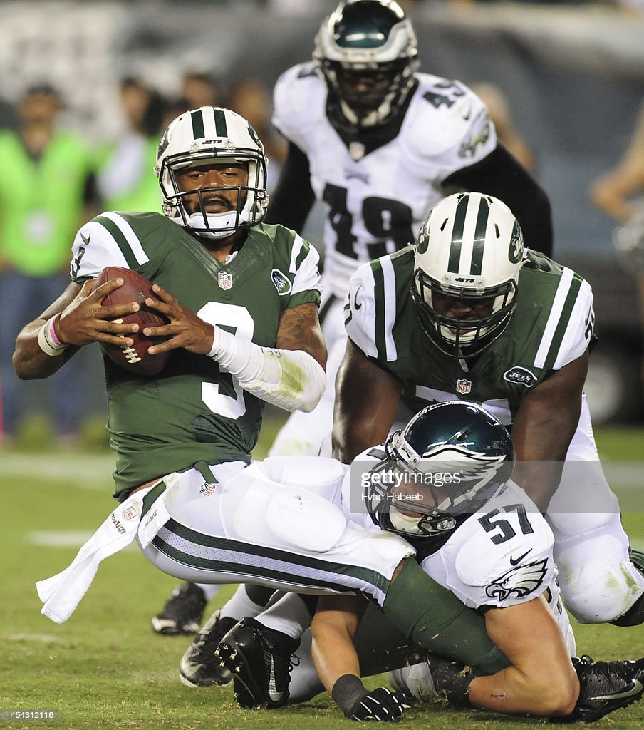 Quarterback Tajh Boyd #3 of the New York Jets is sacked by linebacker Travis Long #57 of the Philadelphia Eagles in the preseason game on August 28, 2014 at Lincoln Financial Field in Philadelphia, Pennsylvania.