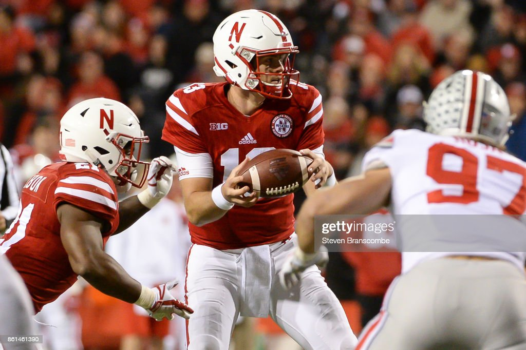 Quarterback Tanner Lee #13 of the Nebraska Cornhuskers fields a snap against the Ohio State Buckeyes at Memorial Stadium on October 14, 2017 in Lincoln, Nebraska.
