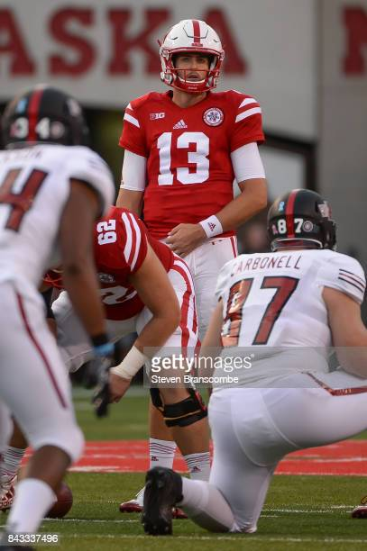 Quarterback Tanner Lee of the Nebraska Cornhuskers looks over the line against the Arkansas State Red Wolves at Memorial Stadium on September 2 2017...
