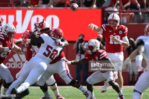 Quarterback Tanner Lee of the Nebraska Cornhuskers passes against the Rutgers Scarlet Knights at Memorial Stadium on September 23 2017 in Lincoln...