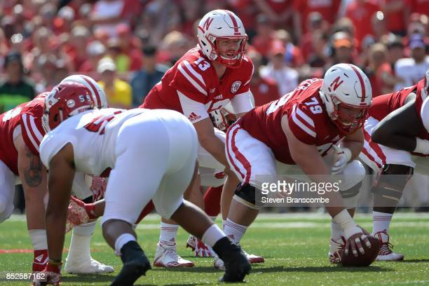 Quarterback Tanner Lee of the Nebraska Cornhuskers takes the snap from Michael Decker against the Rutgers Scarlet Knights at Memorial Stadium on...