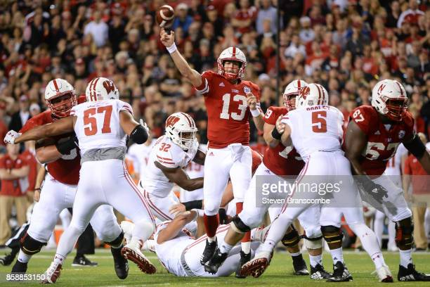Quarterback Tanner Lee of the Nebraska Cornhuskers throws to avoid the rush from the Wisconsin Badgers at Memorial Stadium on October 7 2017 in...