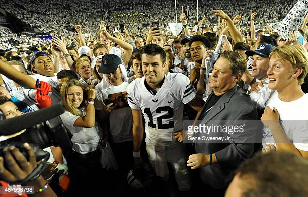 Quarterback Tanner Mangum of the Brigham Young Cougars is surrounded by fans on the field after their 3524 win over the Boise State Broncos at LaVell...