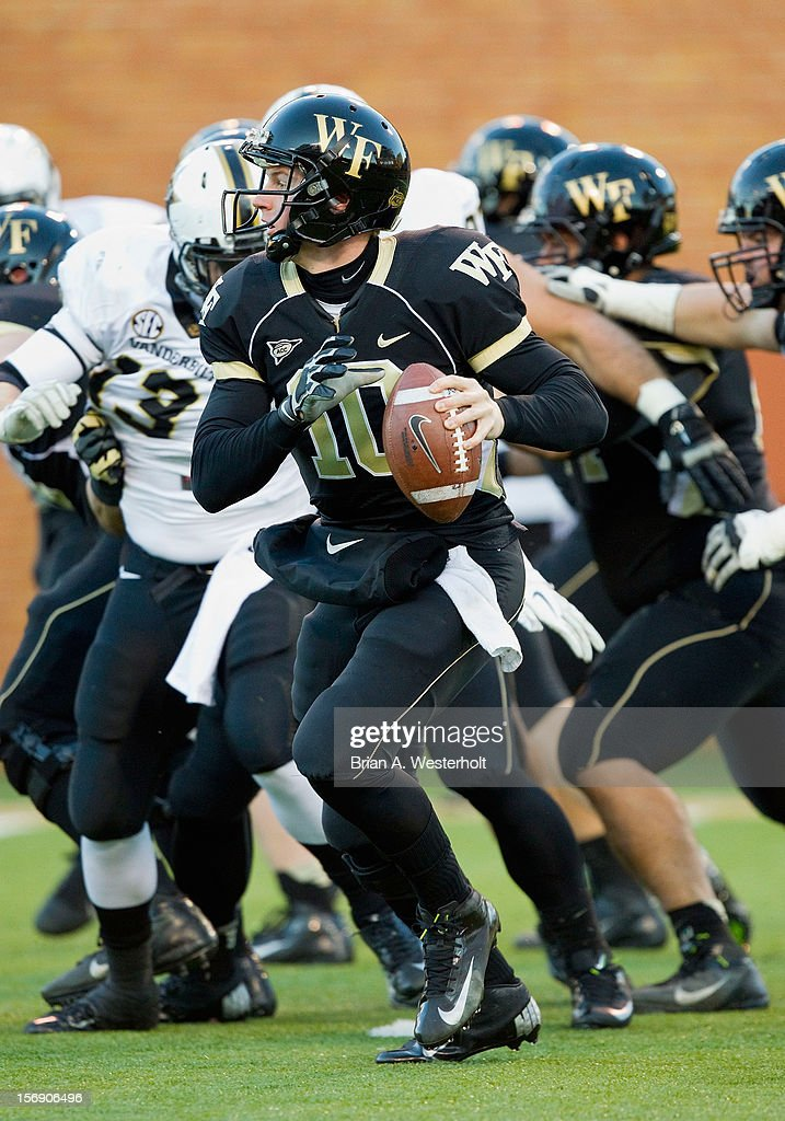 Quarterback <a gi-track='captionPersonalityLinkClicked' href=/galleries/search?phrase=Tanner+Price&family=editorial&specificpeople=7183653 ng-click='$event.stopPropagation()'>Tanner Price</a> #10 of the Wake Forest Demon Deacons rolls out looking to pass the ball against the Vanderbilt Commodores at BB&T Field on November 24, 2012 in Winston Salem, North Carolina.