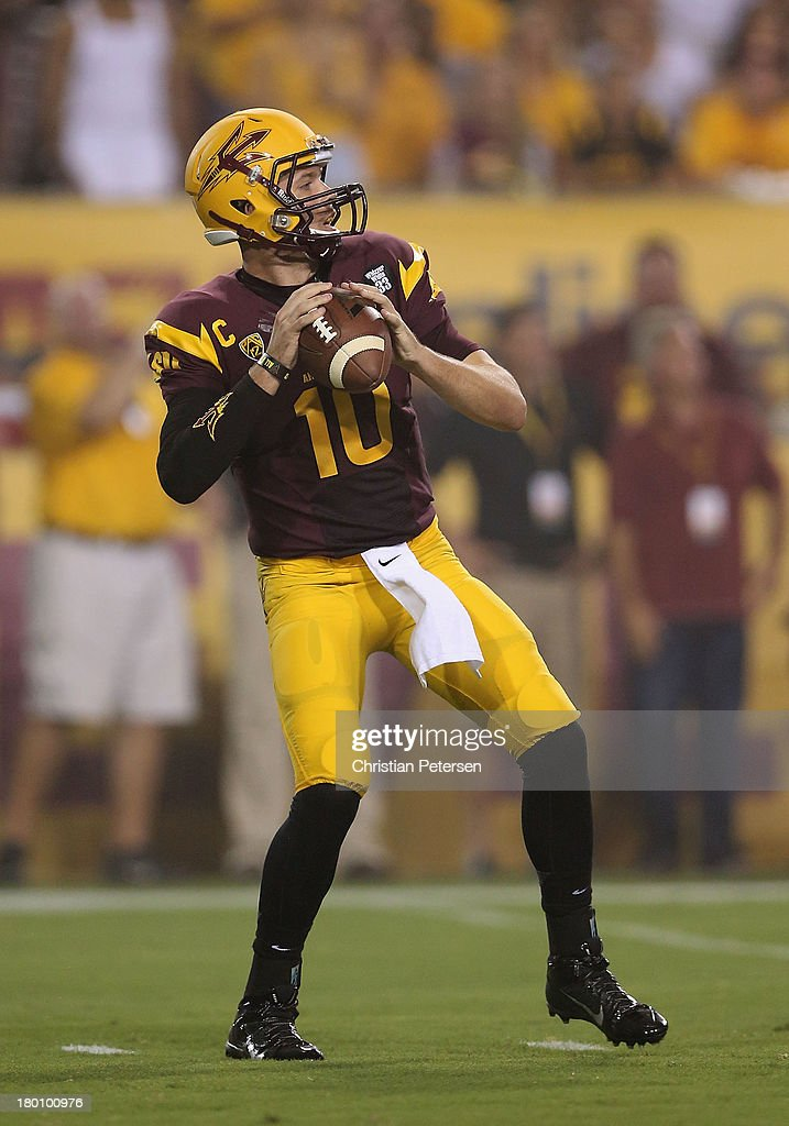 Quarterback Taylor Kelly #10 of the Arizona State Sun Devils drops back to pass during the college football game against the Sacramento State Hornets at Sun Devil Stadium on September 5, 2013 in Tempe, Arizona.