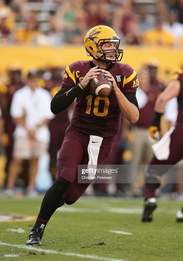 Quarterback Taylor Kelly #10 of the Arizona State Sun Devils drops back to pass during the college football game against the Washington Huskies at Sun Devil Stadium on October 19, 2013 in Tempe, Arizona. The Sun Devils defeated the Huskies 53-24.