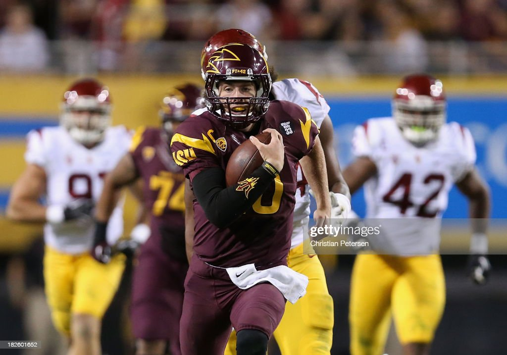 Quarterback Taylor Kelly #10 of the Arizona State Sun Devils rushes the football against the USC Trojans during the college football game at Sun Devil Stadium on September 28, 2013 in Tempe, Arizona. The Sun Devils defeated the Trojans 62-41.