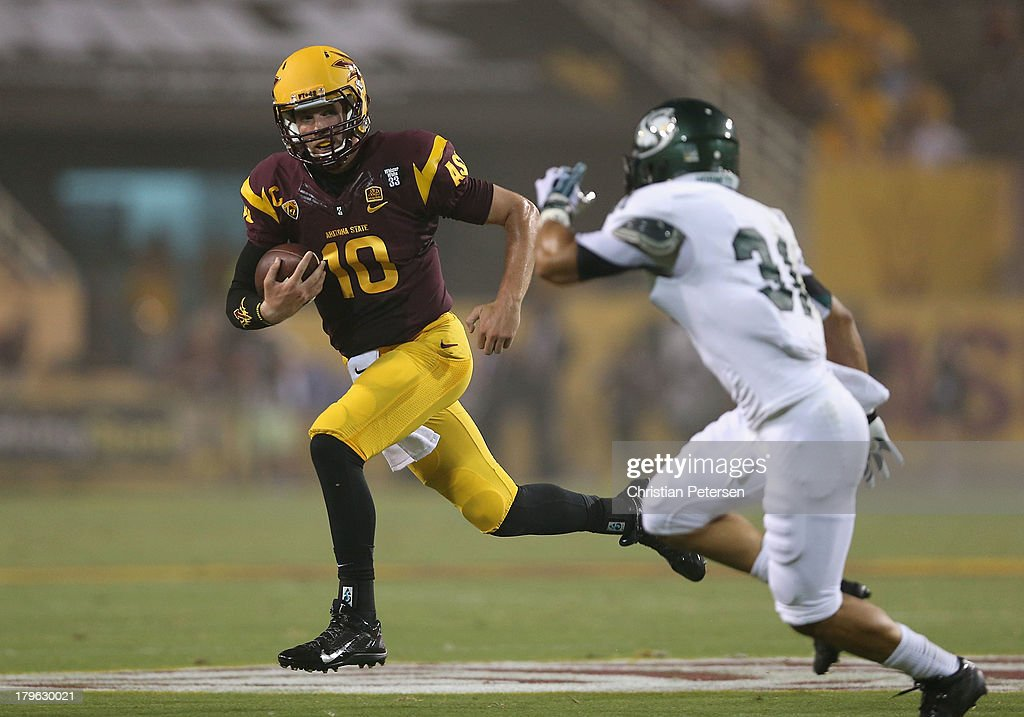 Quarterback Taylor Kelly #10 of the Arizona State Sun Devils scrambles with the football against defensive back Markell Williams #31 of the Sacramento State Hornets during the first quarter of the college football game at Sun Devil Stadium on September 5, 2013 in Tempe, Arizona.