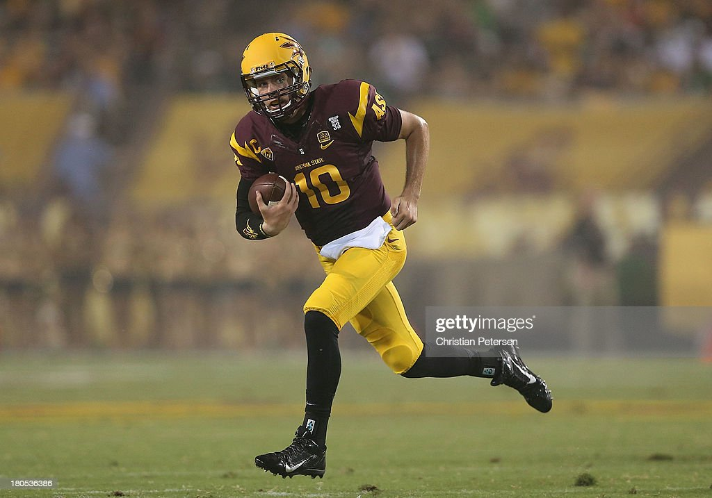 Quarterback Taylor Kelly #10 of the Arizona State Sun Devils scrambles with the football during the college football game against the Sacramento State Hornets at Sun Devil Stadium on September 5, 2013 in Tempe, Arizona.