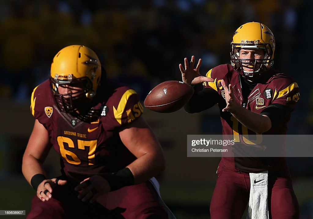 Quarterback Taylor Kelly #10 of the Arizona State Sun Devils snaps the football during the college football game against the Washington Huskies at Sun Devil Stadium on October 19, 2013 in Tempe, Arizona. The Sun Devils defeated the Huskies 53-24.