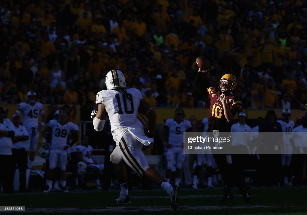 Quarterback Taylor Kelly #10 of the Arizona State Sun Devils throws a pass during the college football game against the Washington Huskies at Sun Devil Stadium on October 19, 2013 in Tempe, Arizona. The Sun Devils defeated the Huskies 53-24.