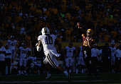 Quarterback Taylor Kelly of the Arizona State Sun Devils throws a pass during the college football game against the Washington Huskies at Sun Devil...