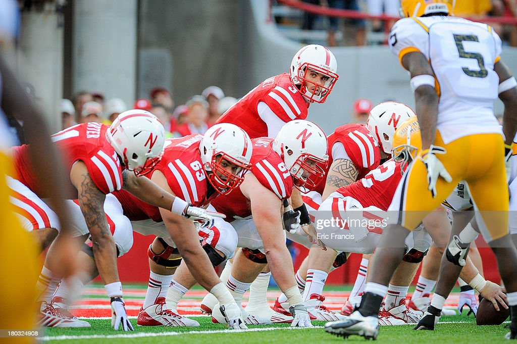 Quarterback Taylor Martinez #3 of the Nebraska Cornhuskers and his offensive line prepare to snap the ball during their game against the Southern Miss Golden Eagles at Memorial Stadium on September 7, 2013 in Lincoln, Nebraska.